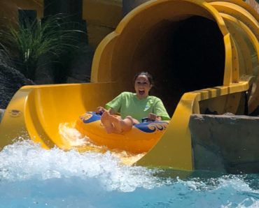 Rider on water slide