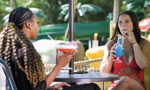 Two women enjoying adult beverages
